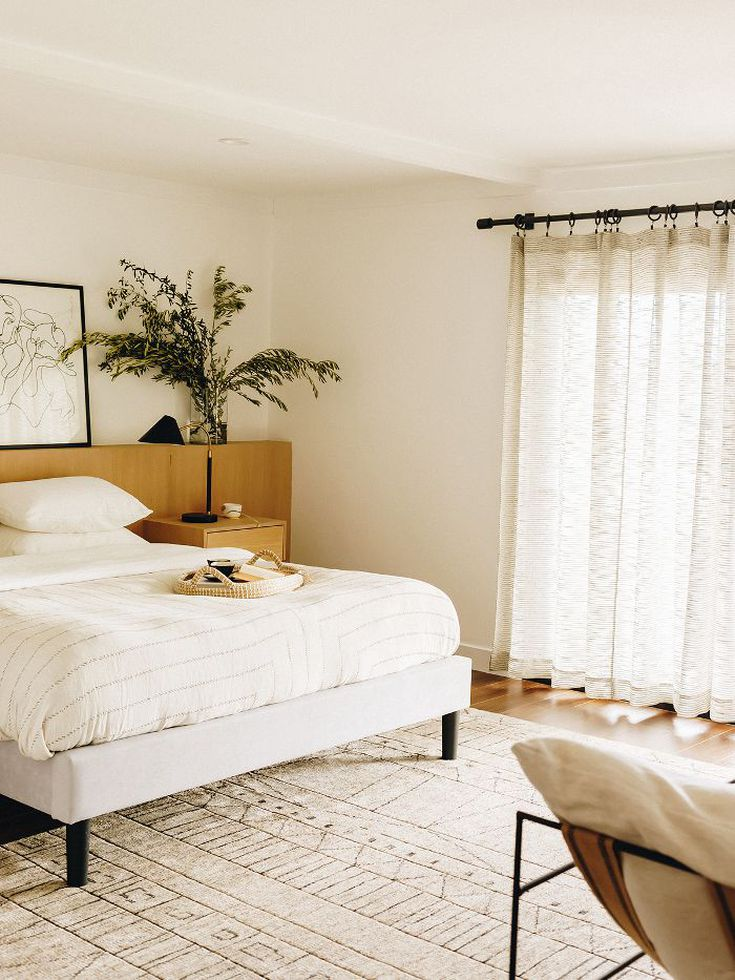 This stylish master bedroom has a zen, spa-like quality to it that feels extremely calming and serene. Photo: Karla Ticas; Design: Erick Garcia of Maison Trouvaille