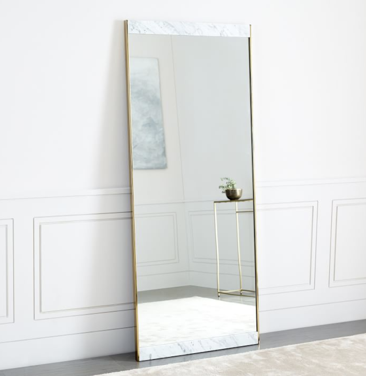 Marble + Brass - Floor mirror in marble and brushed brass, $499; West Elm