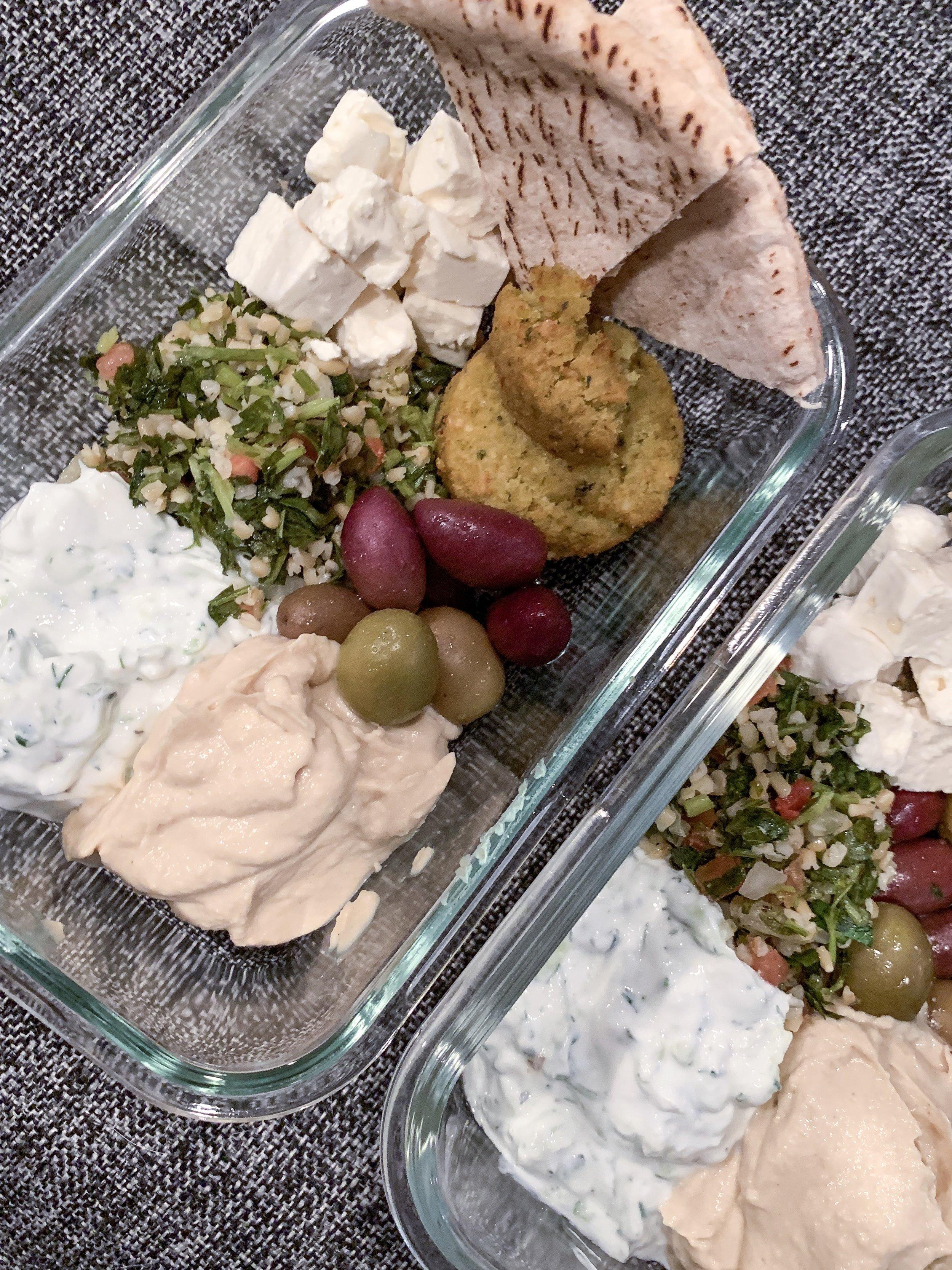 Mediterranean and Greek meal prep lumch bento box with tzatziki hummus and falafel