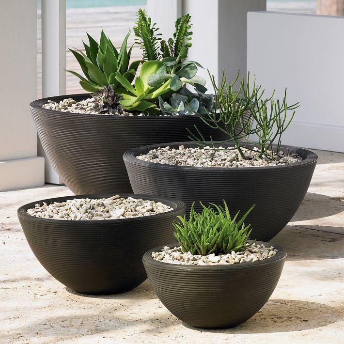 """""""Delano"""" - Outdoor Caviar Black planters, $49-319; West Elm"""
