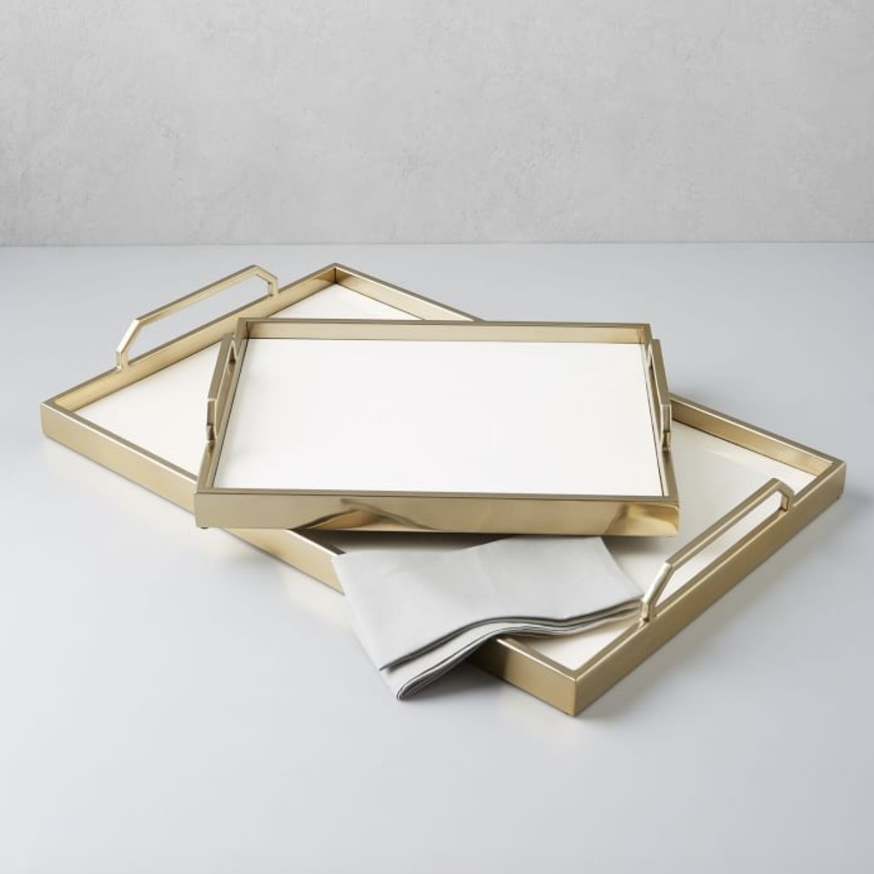 Enamel Café Tray - Brass tray with handle, $99; West Elm