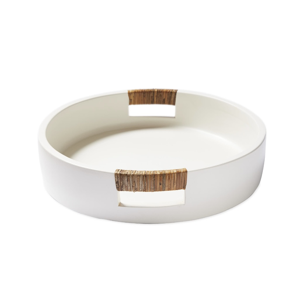 """Spinnaker"" - Round tray with rattan handles, $128; Serena & Lily"