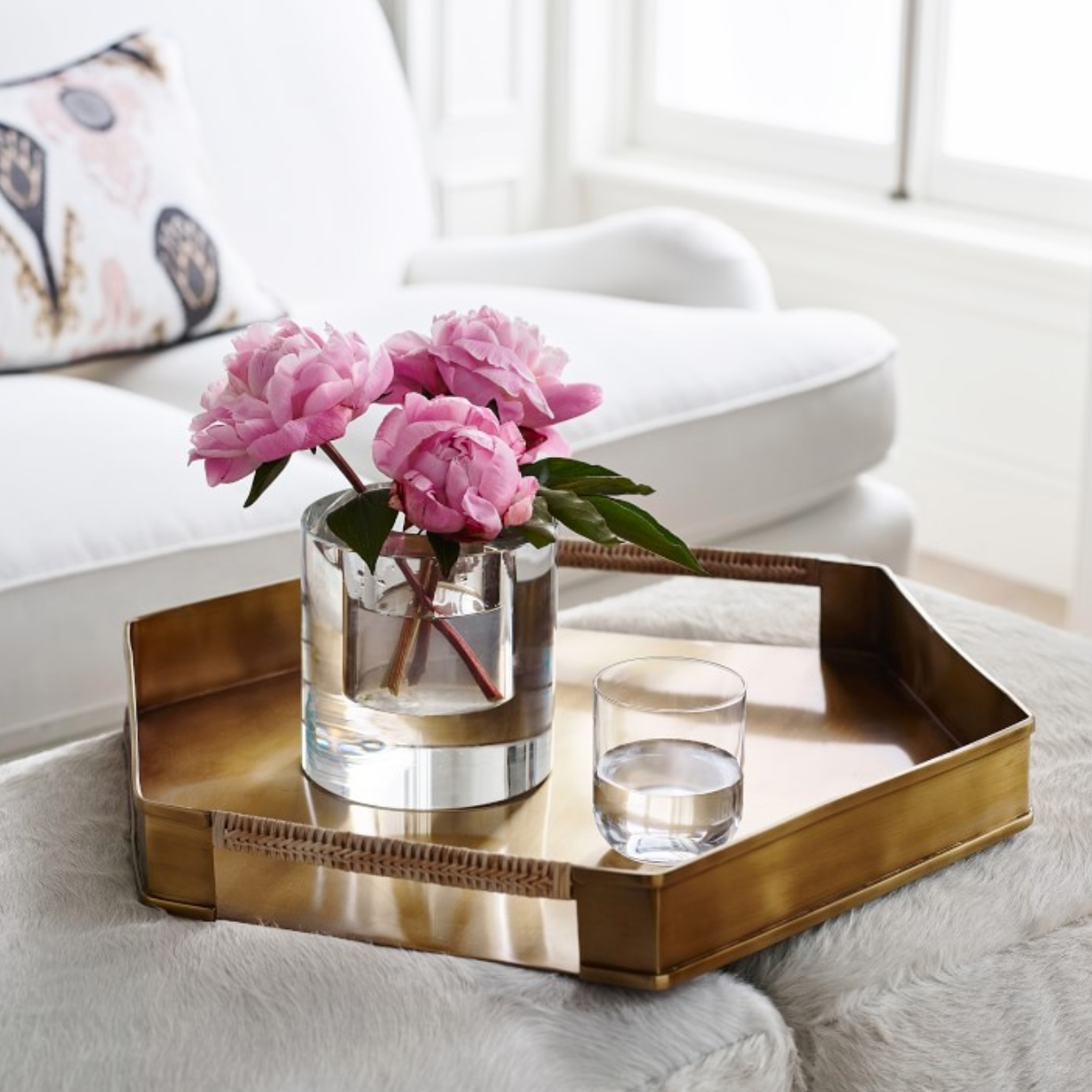Hexagonal Tray - Brass tray with rattan handles from Paloma Contreras, $250; Williams-Sonoma