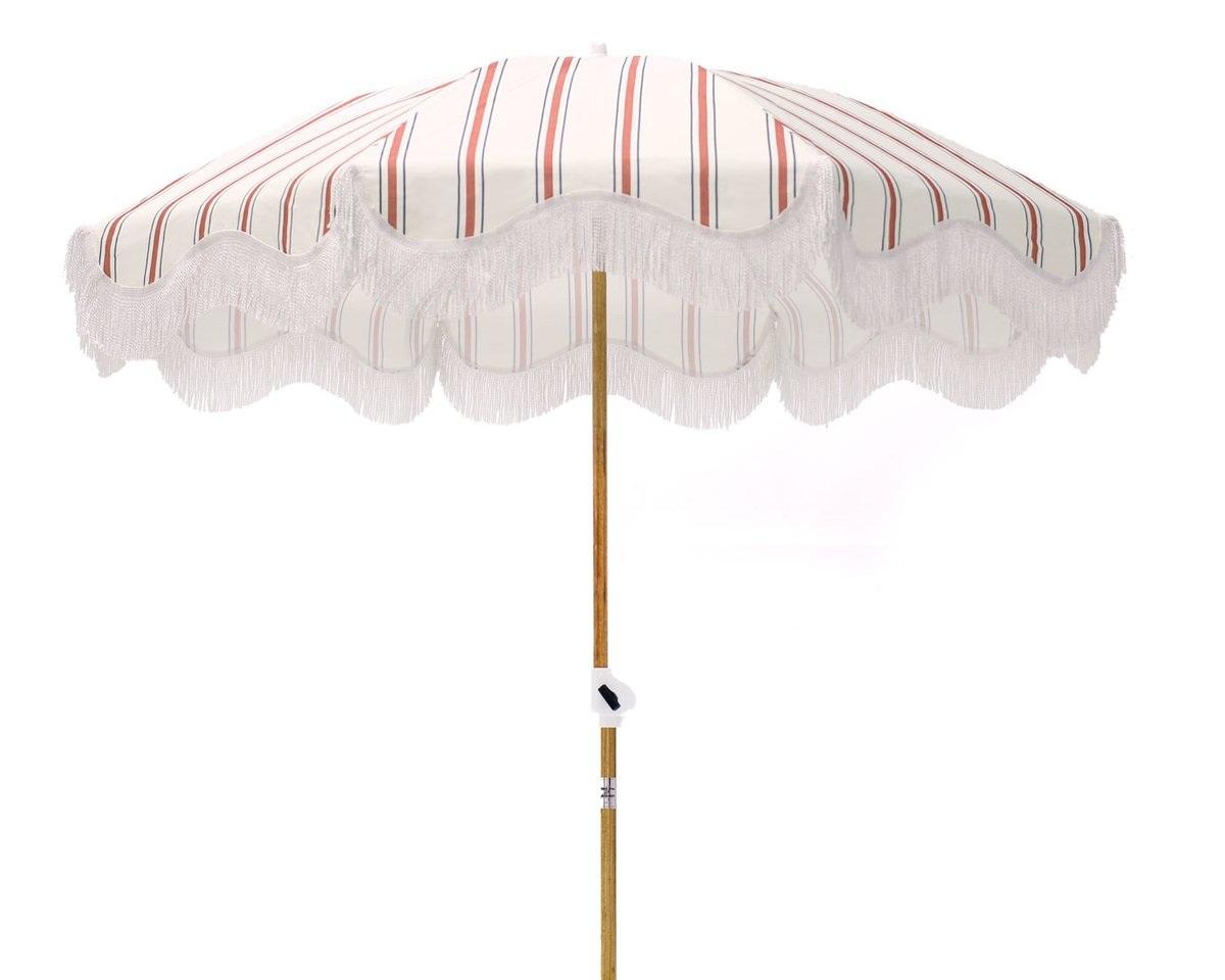 beach umbrella - French stripe umbrella, $150; Business & Pleasure Co.