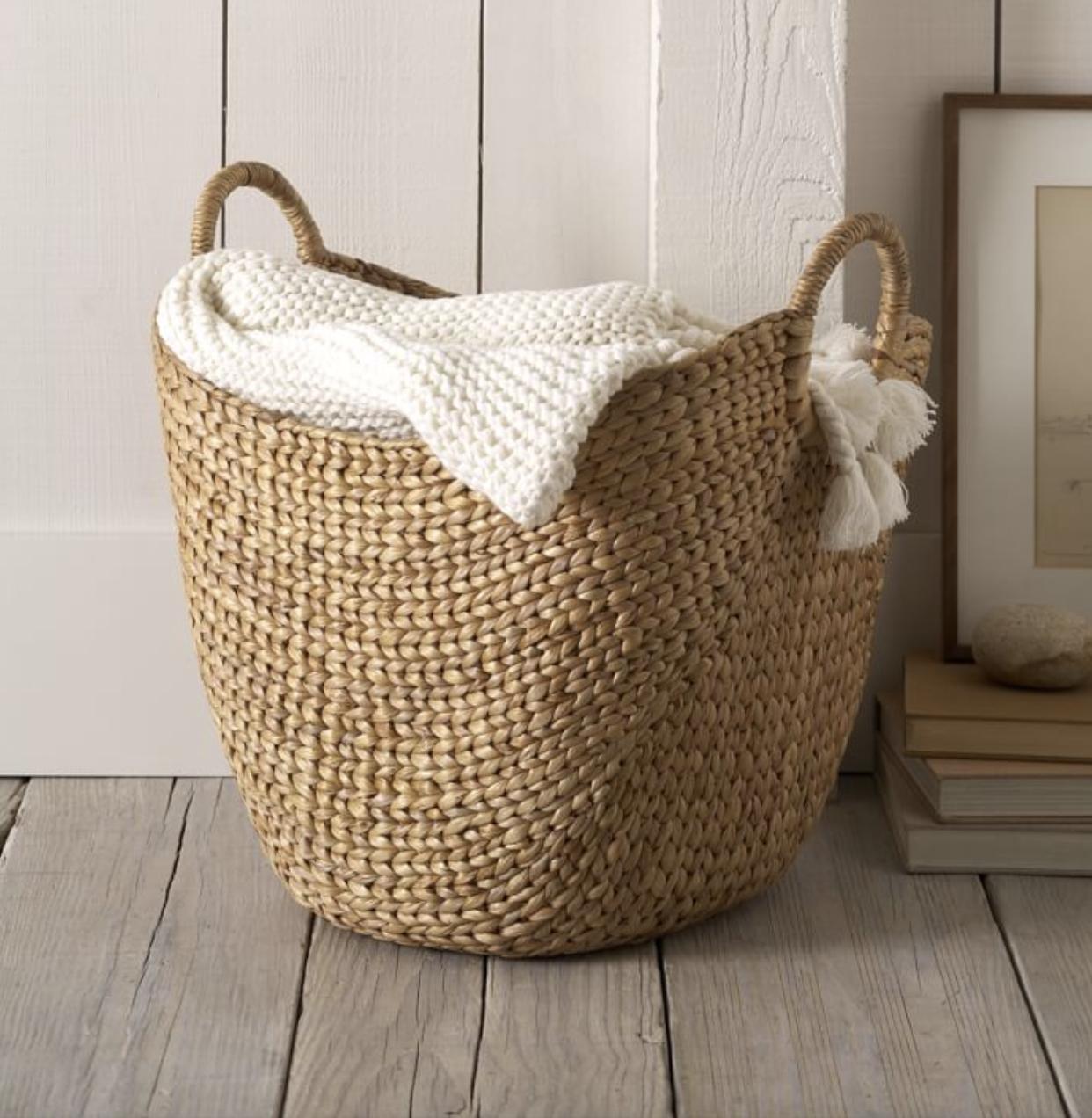 Curved basket - Large natural basket, $54; West Elm