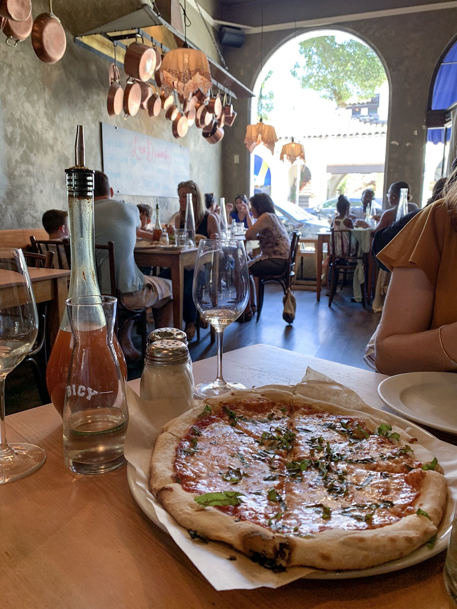 Margherita pizza and rose from La Bicyclette in Carmel-by-the-Sea, California.