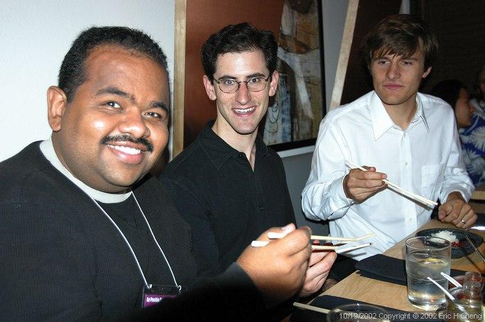 Pablo practices using chopsticks, at Oki Doki (with Matt, and Ben)