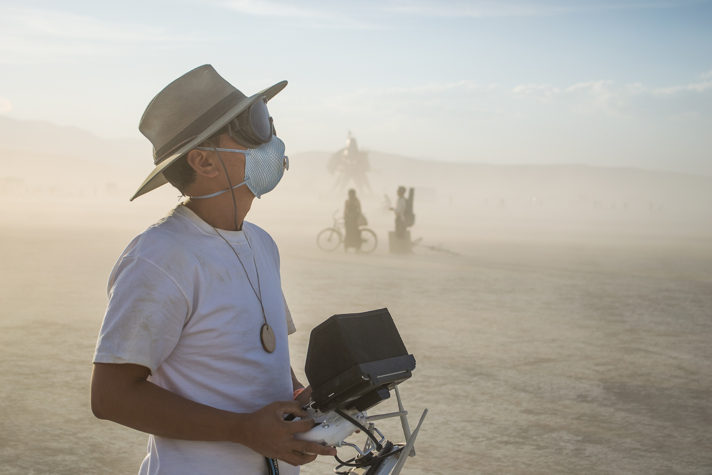 Eric Cheng flies a DJI Phantom 2 out on the playa (photo: Gerard Mattimoe)