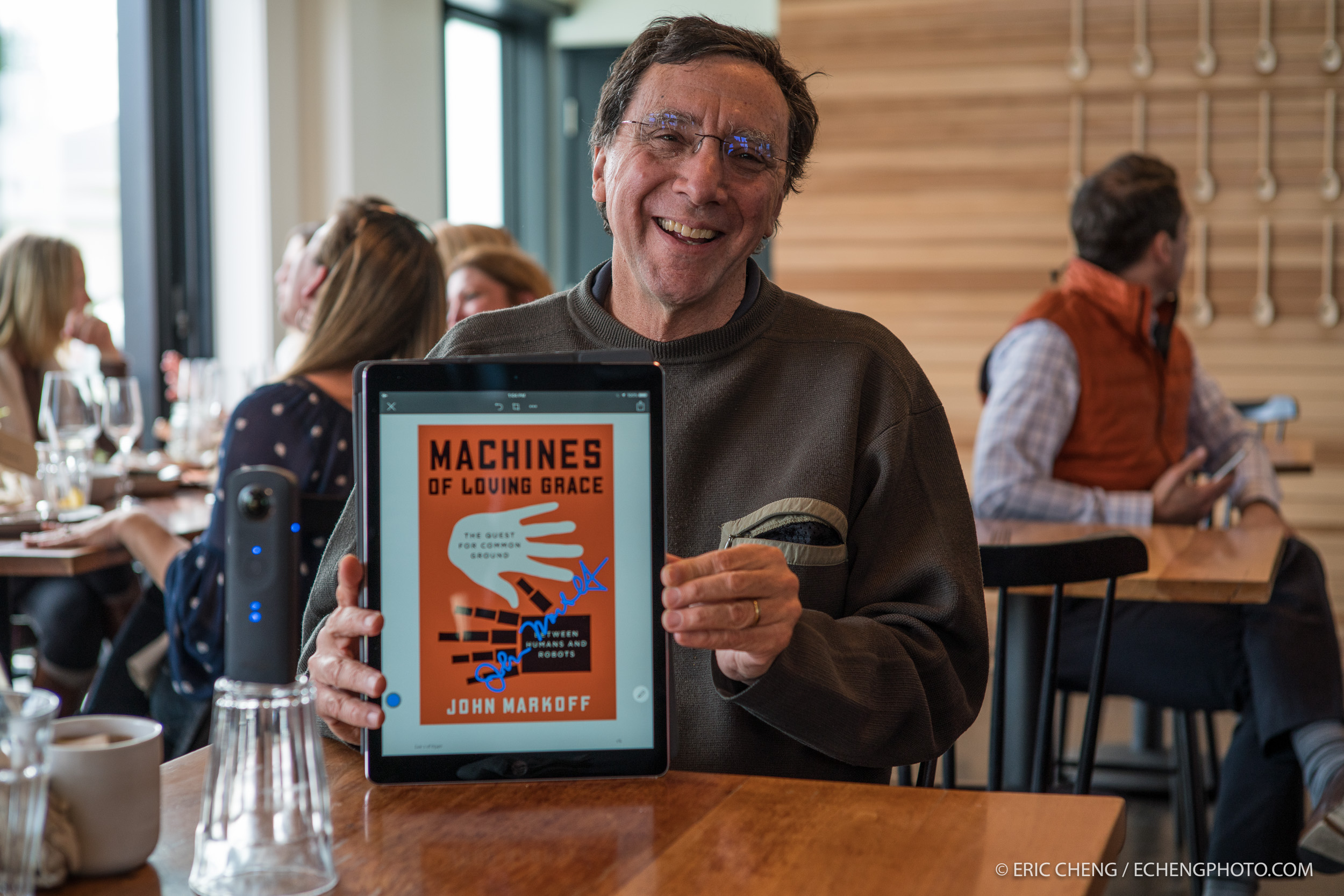 "John Markoff e-signs his book, ""Machines of Loving Grace"""