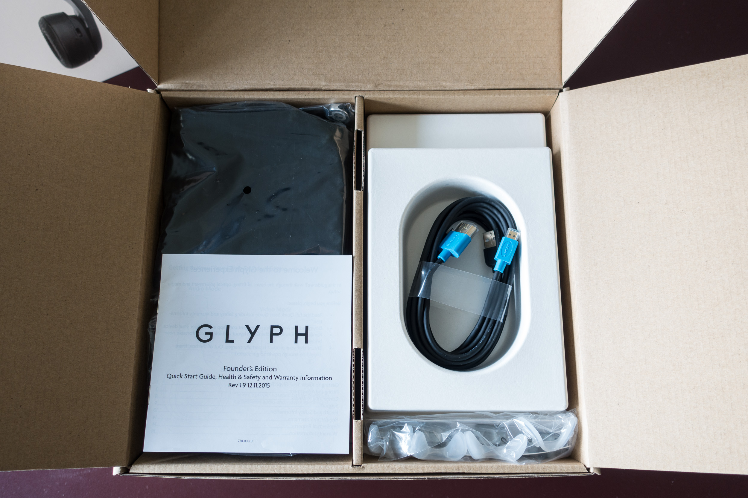 Avegant Glyph Founder's Edition unboxing: top layer includes manual, cables, nose pieces, and bag