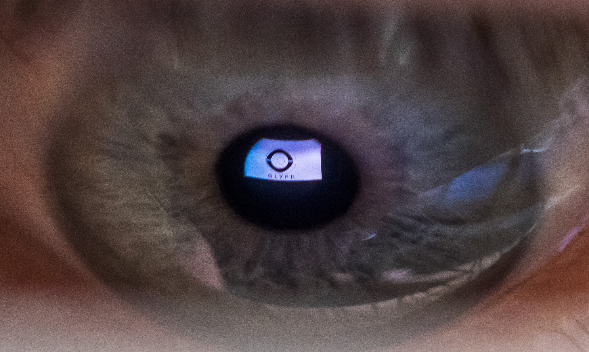 The micro-mirror display of an Avegant Glyph is reflected in cellist Phillip Sheppard's eye