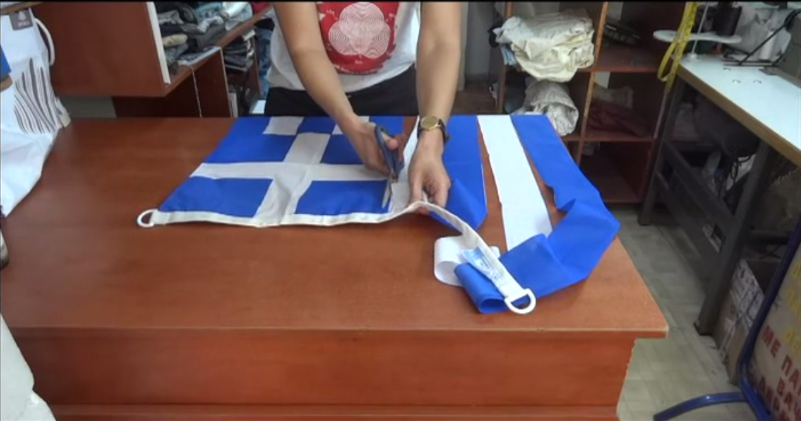Greek Flag Alteration, Athens, 2014. Video still from process. Image courtesy of Sofia Dona.