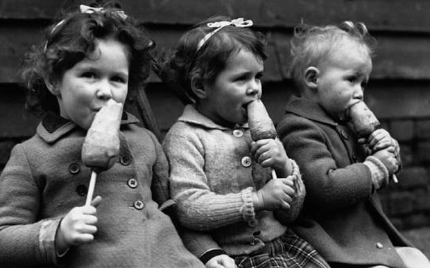 Children eating carrots on a stick during WW II Photo: Ghetty