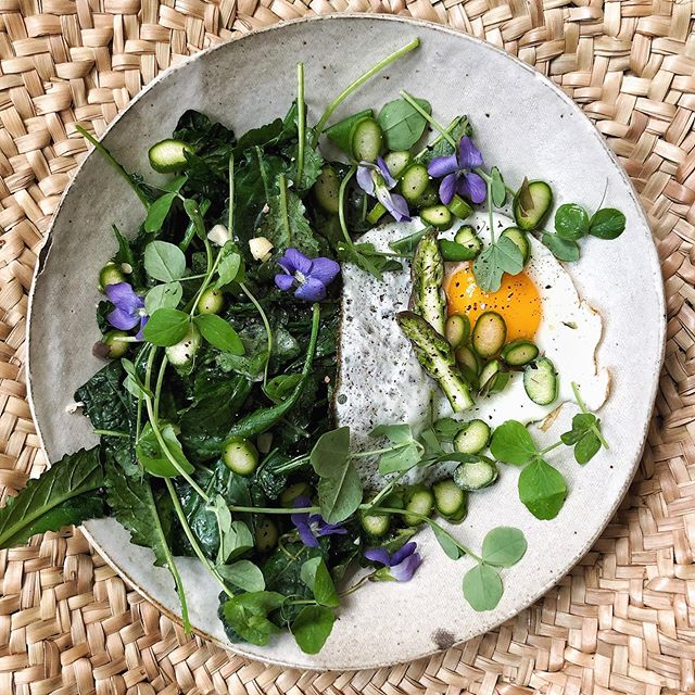 Post farmers' market breakfast was ONE precious raw spear of asparagus sliced thinly with an egg, wilted kale, pea shoots and violets. I spent $10 on a bunch of local organic asparagus and I'm savoring every stalk.