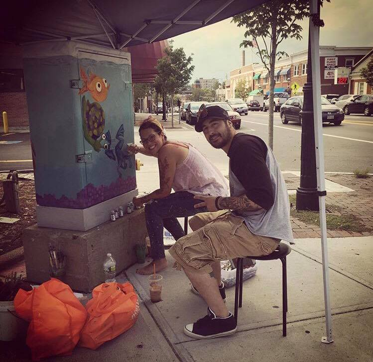 Creating Art In Unusual Places - Local artists @jamie88mack and @melissasbuddingartists working on their art piece in Downtown Peabody.