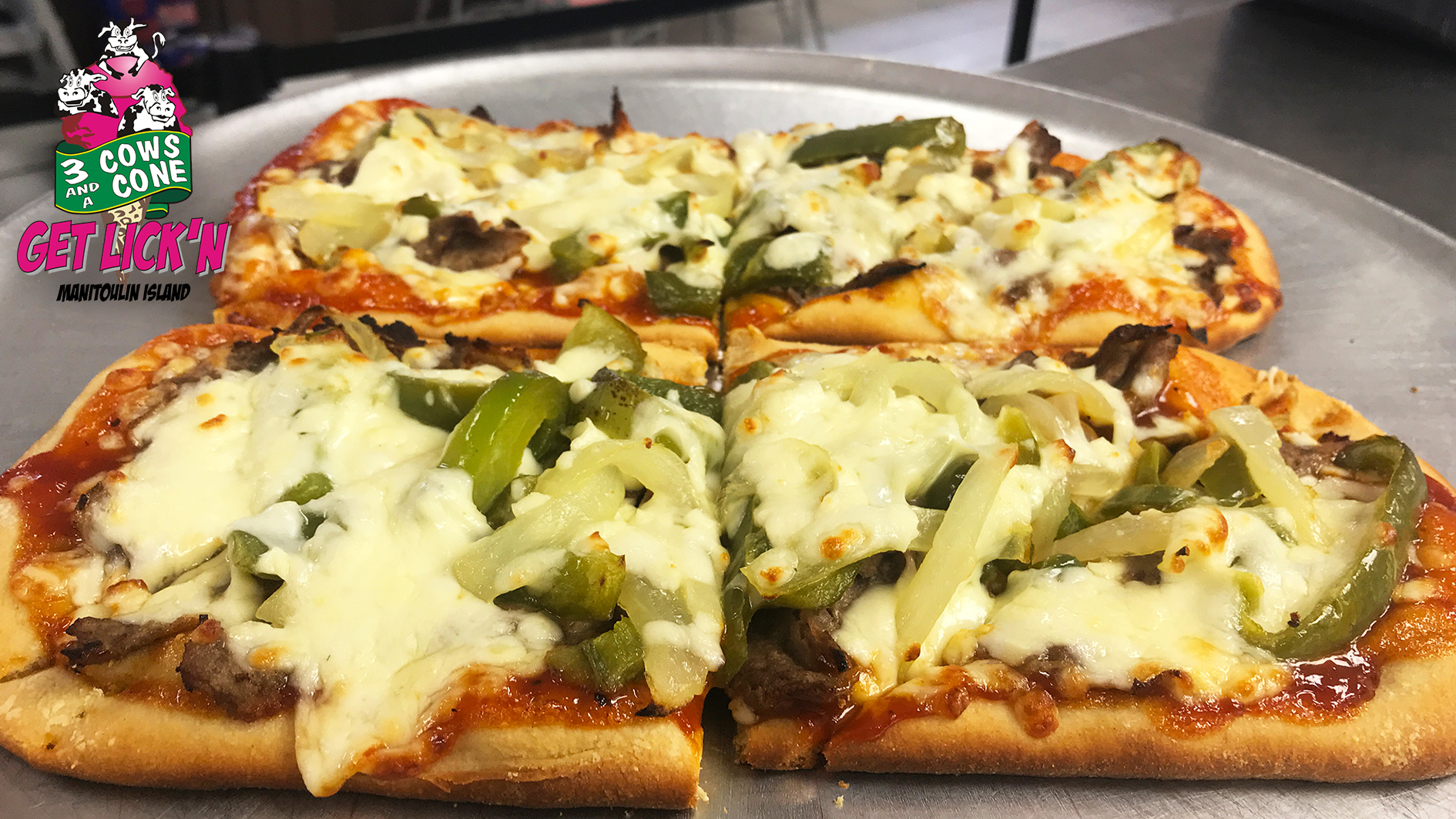 3 Cows and a Cone Philly Cheese flatbread.  Made with BBQ sauce, beef slices, green peppers, onions, and mozzarella