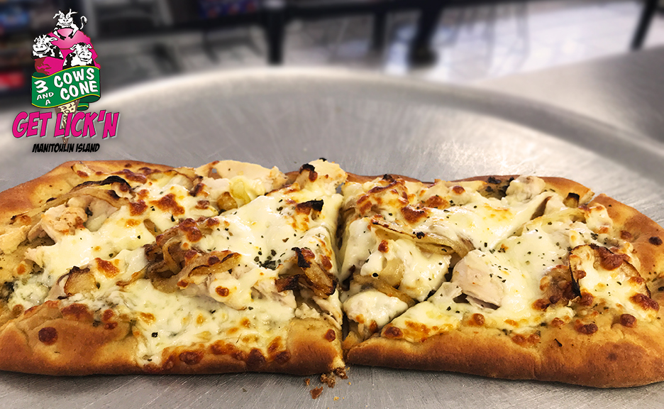 3 Cows and a Cone Chicken Pesto flatbread.  Made with pesto sauce, grilled chicken, mushrooms, and caramelized onions