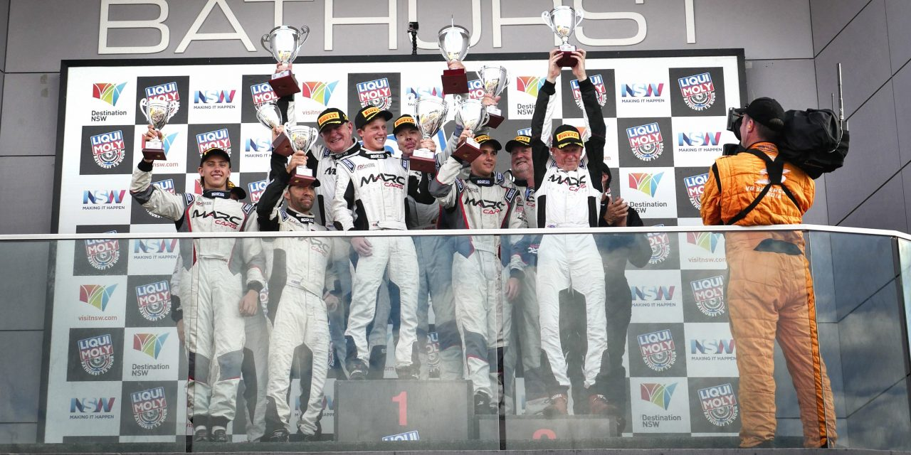 Will Brown is seen on the podium after claiming victory in lass in the 2017 Bathurst 12 HR race