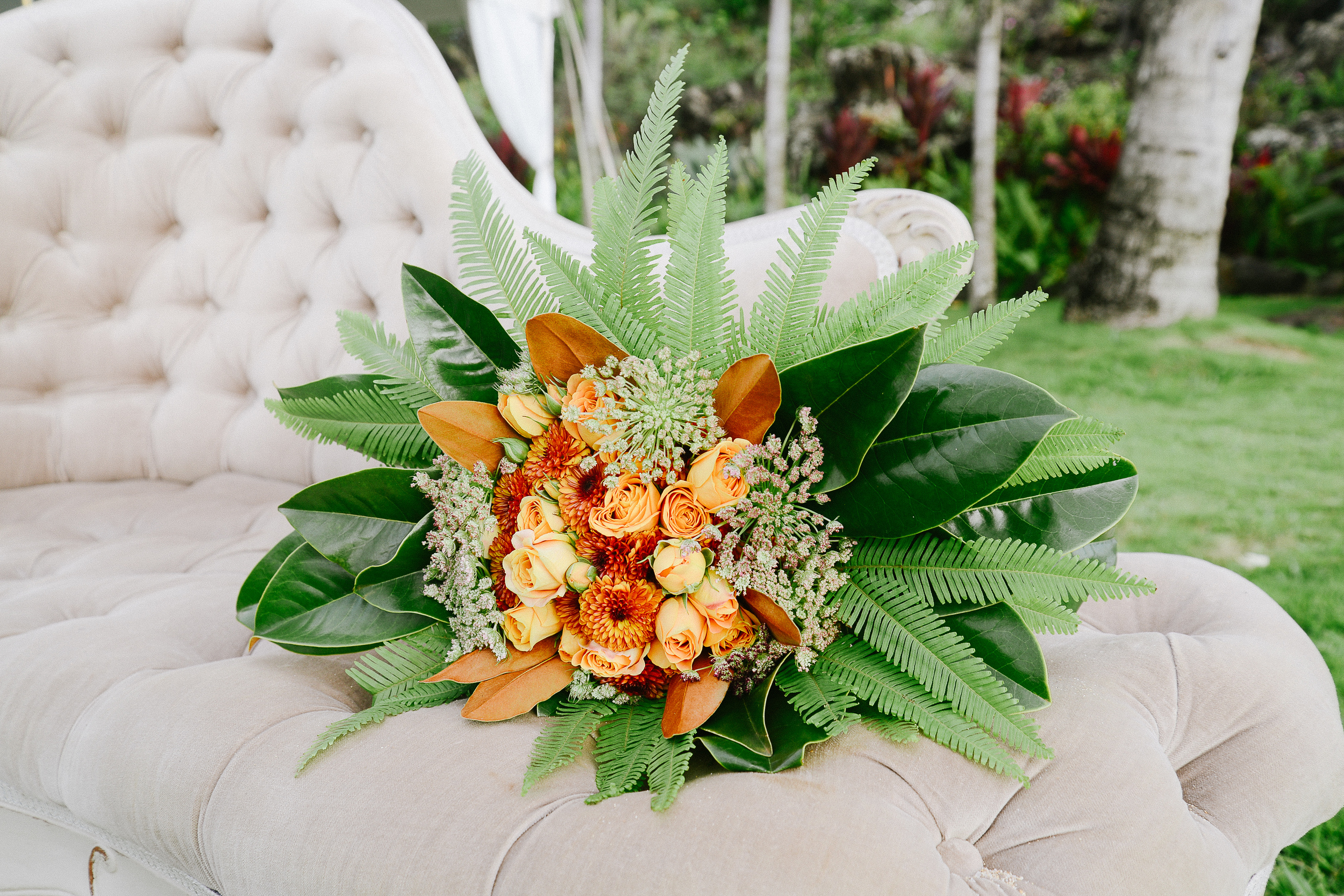 orange and leafy greenery bouquet