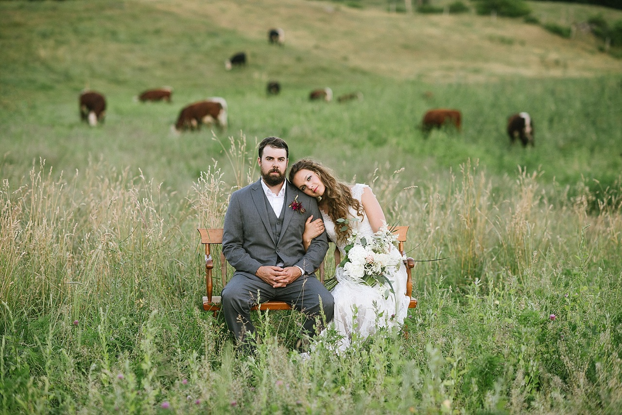 Bride and Groom on a Bench in a NH Cow Field