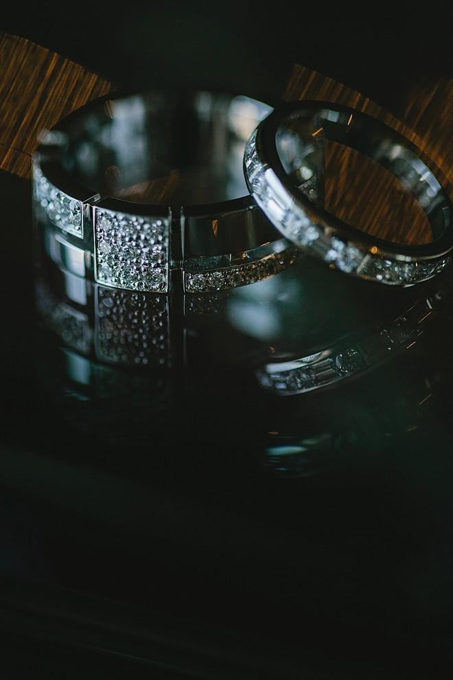 wedding rings on black surface