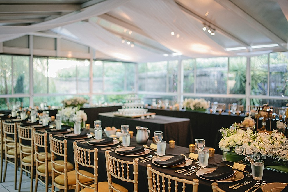 black and gold wedding inspiration with chiavari chairs