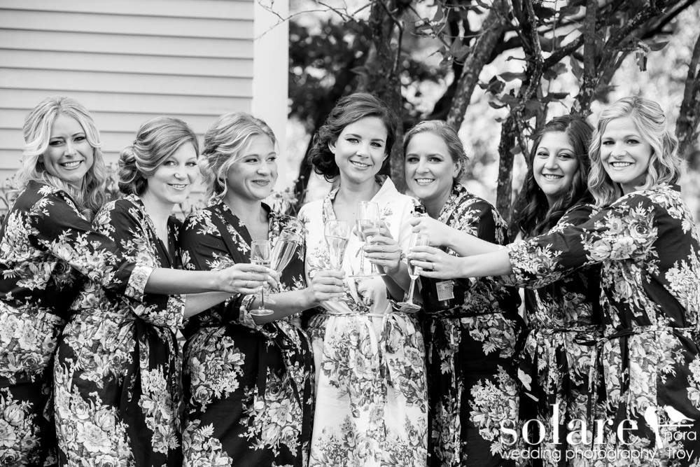 Bride and bridesmaids in robes for toast