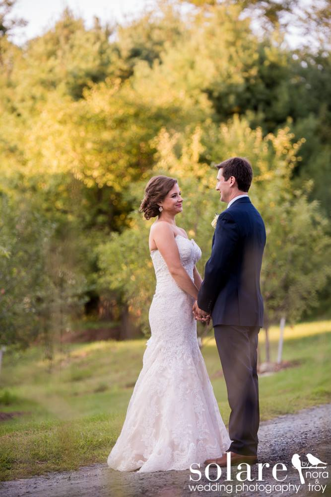 bride and groom on vermont dirt road