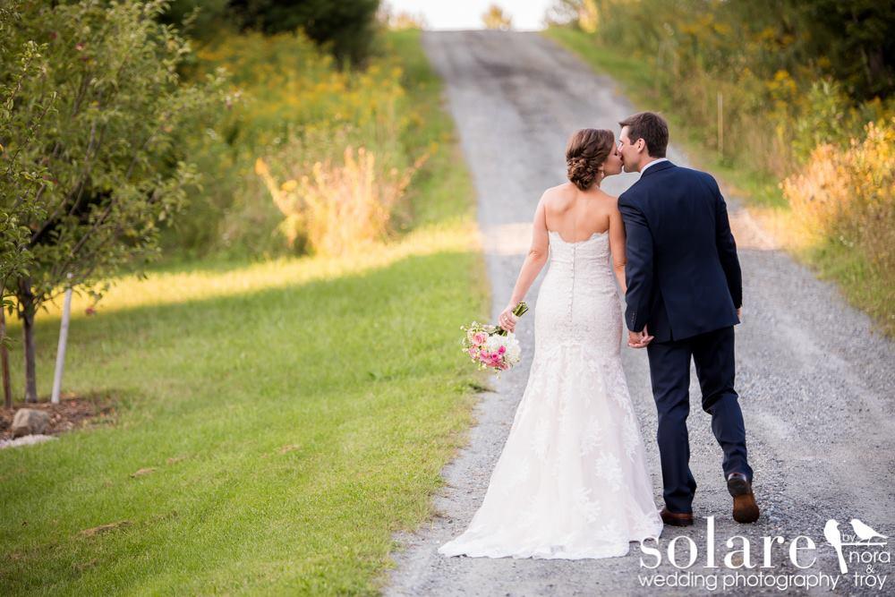 windy dirt road on wedding day