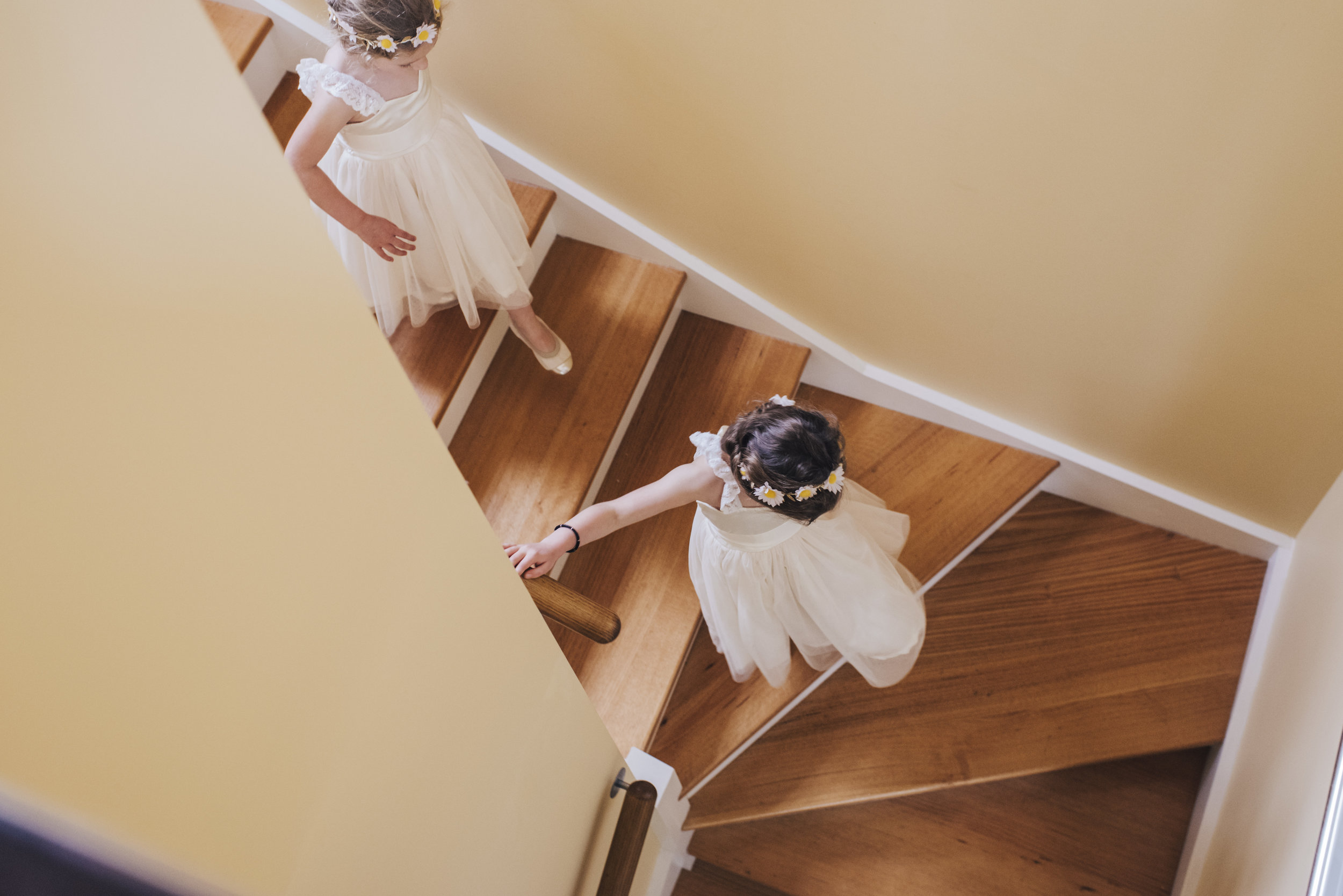Flower Girls running down stairs