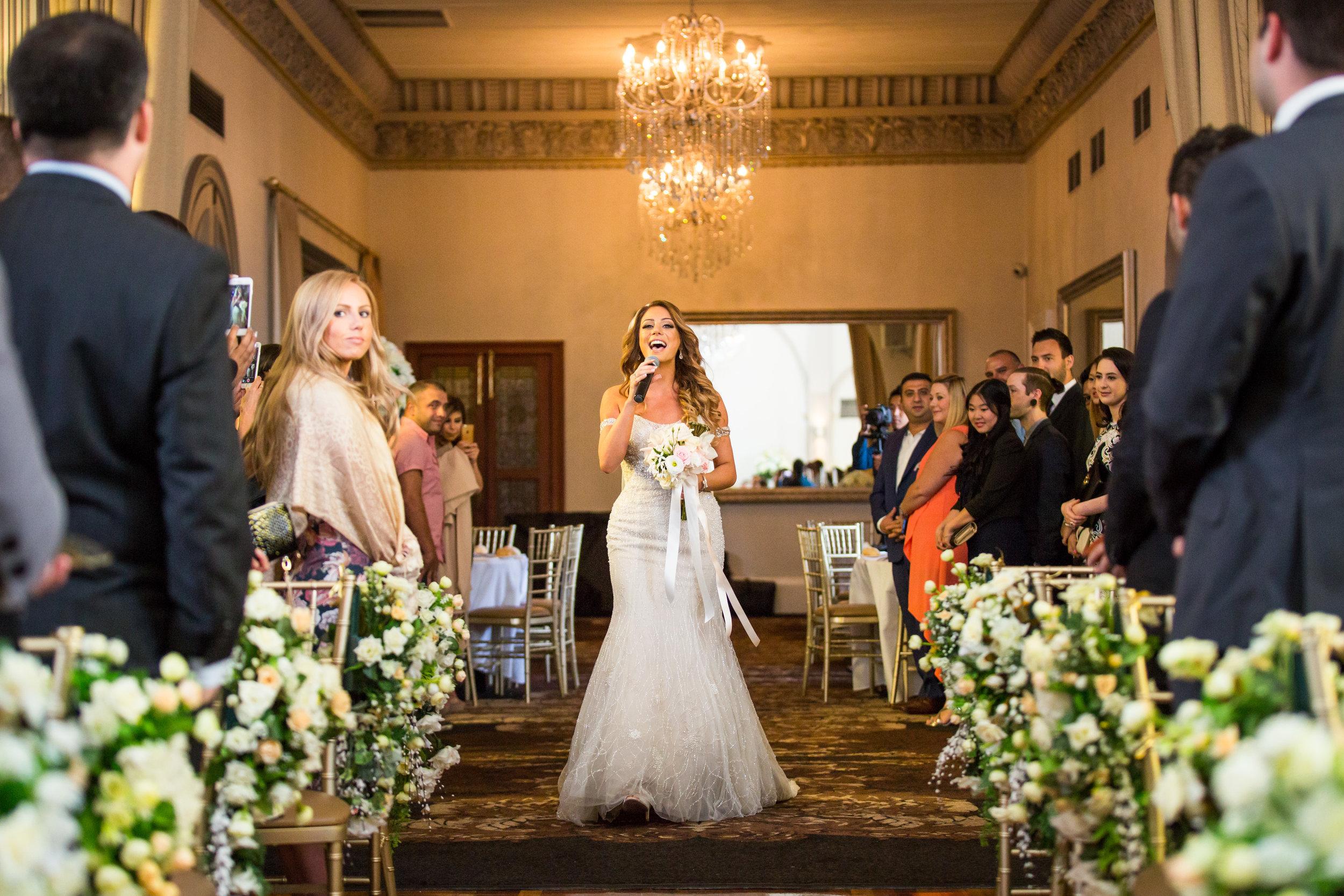 bride walking down aisle singing