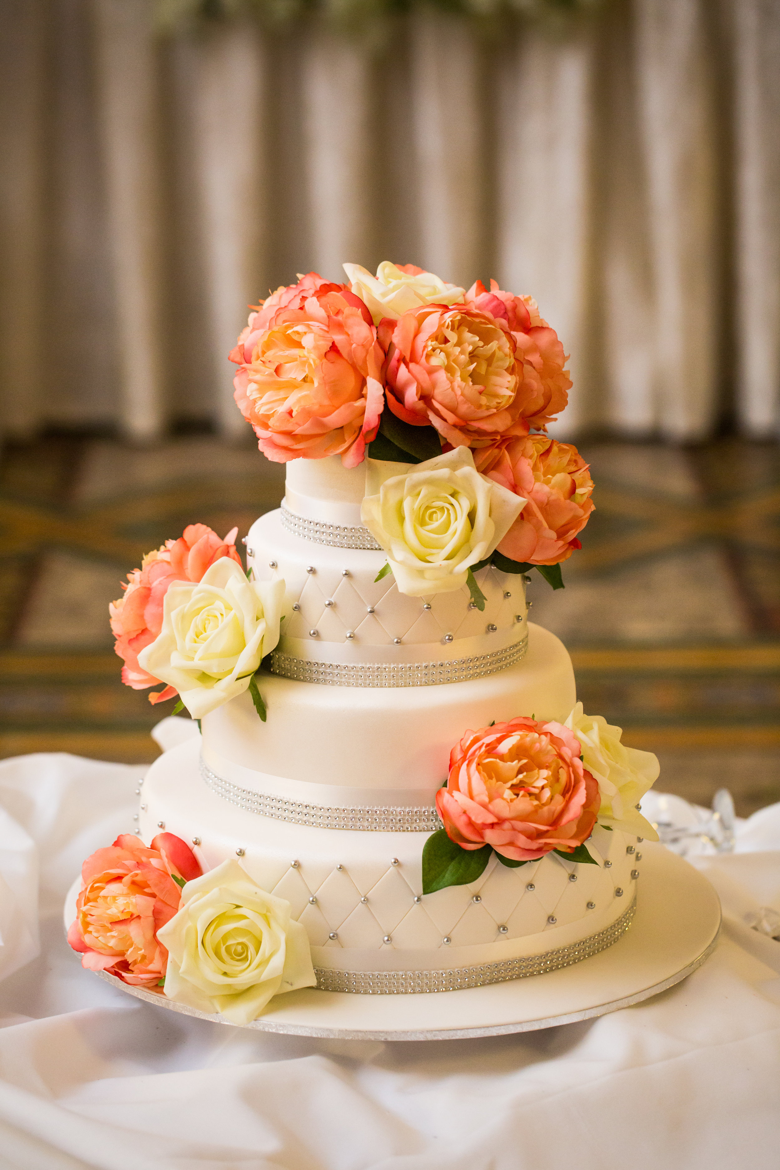 Quilted Wedding Cake with pink flowers
