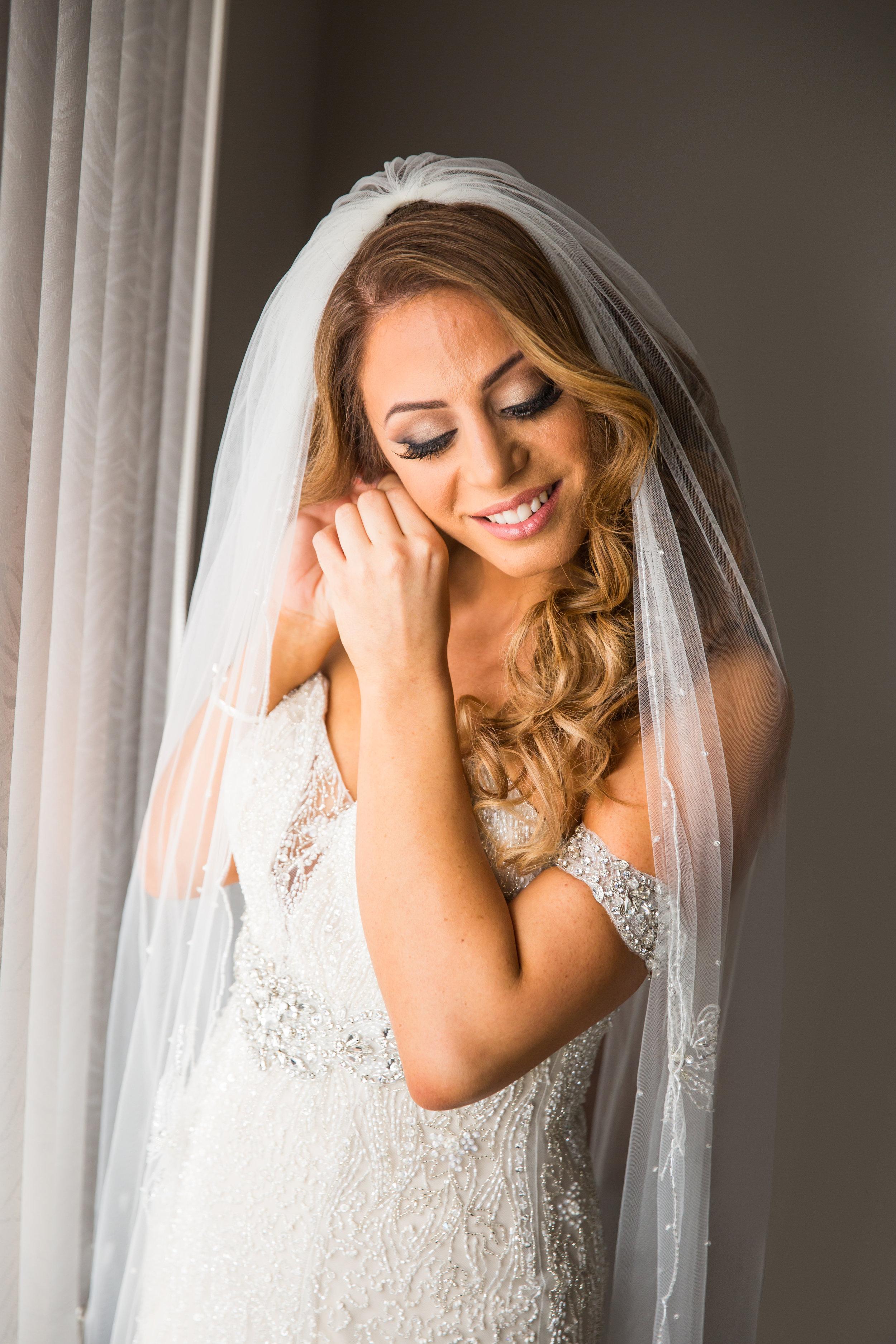 bride putting earrings in   curzon hall marsfield australia