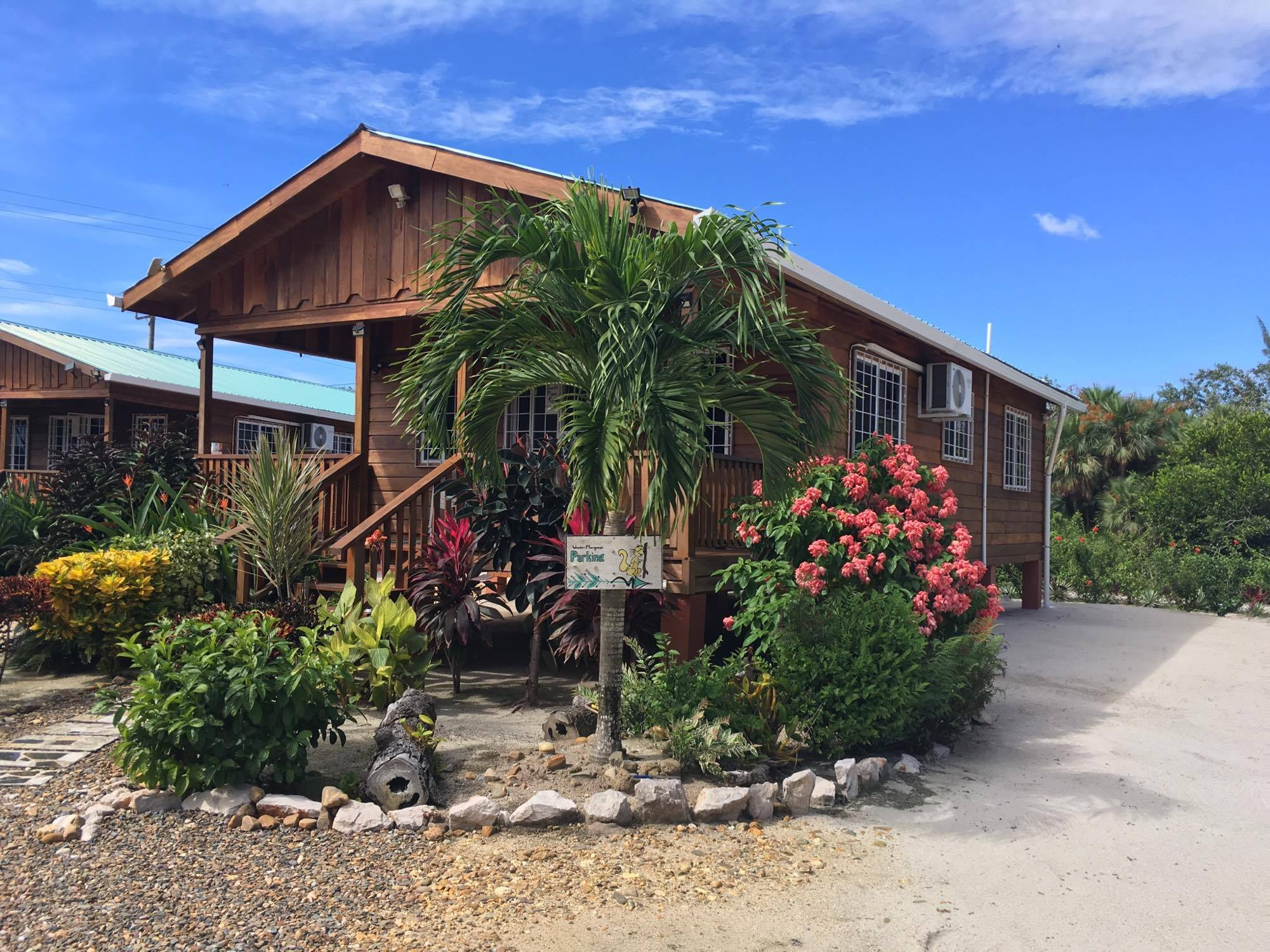 Two identical cabanas, full kitchens, fully furnished, private parking, covered porch