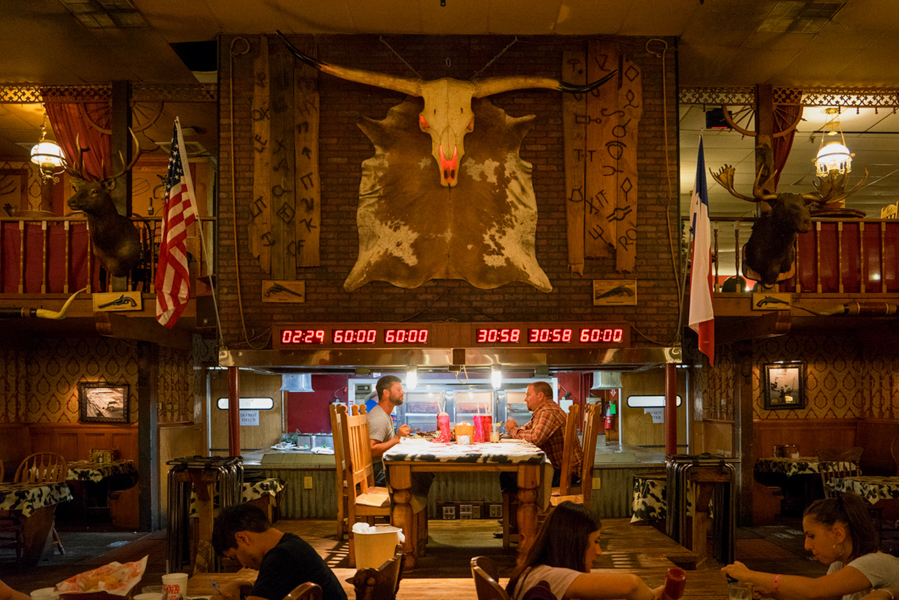 "The Big Texan, Amarillo, TX   Being fans of food and the overindulgent adventures of Man vs. Food, we were more than excited for a meal at the Big Texan.  This roadside attraction is famed for their ""72oz Steak Challenge"".  The challenge is basically an impossible feat where a contestant has one hour to eat a 72oz steak, a baked potato, a bread roll, and a salad.  Eat it all and it's free, fail miserably and you have quite the bill to pay.  We stuck to something a little more manageable, although Jenny did contemplate attempting the challenge in the midst of her hunger.  We were lucky enough to watch two men attempt the challenge and fail."