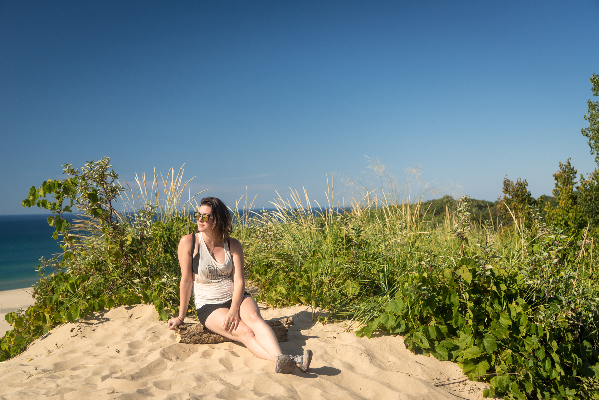 Jenny sitting on top of Warren Dunes State Park's Tower Hill