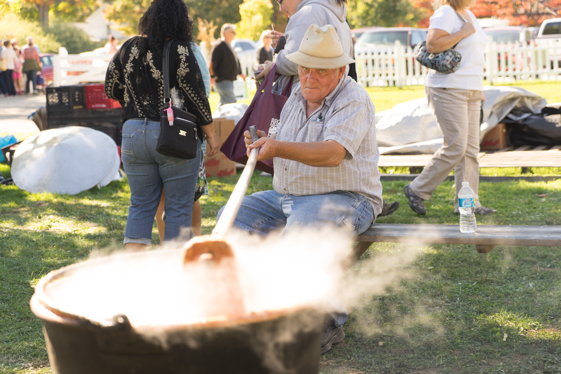 Man churning the apple butter (Cleveland, Ohio)