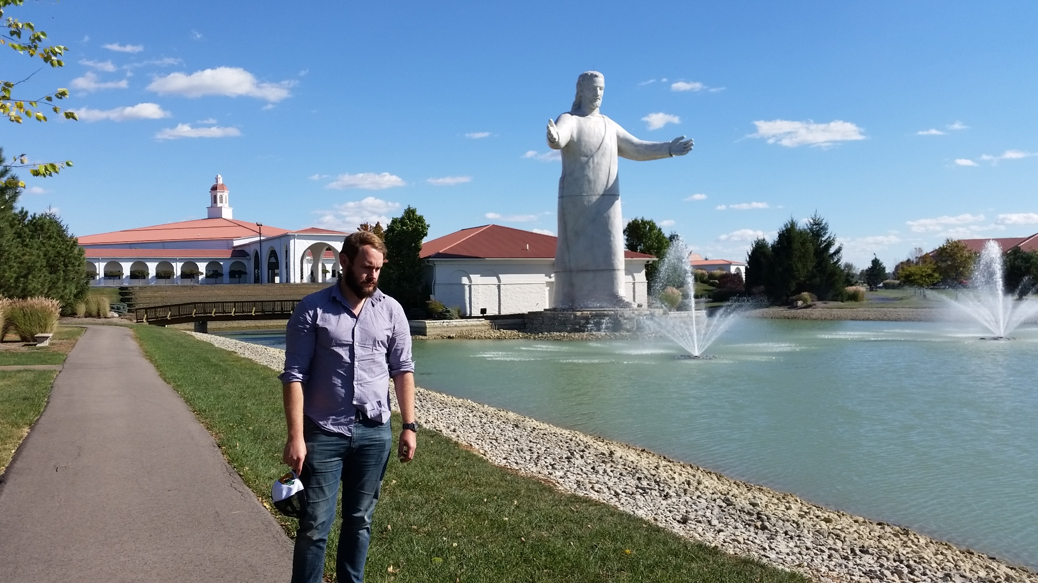 """Jason disappointed that on our way to Cincinnati the fabled """"big butter Jesus"""" was remade to a smaller, less fun statue"""