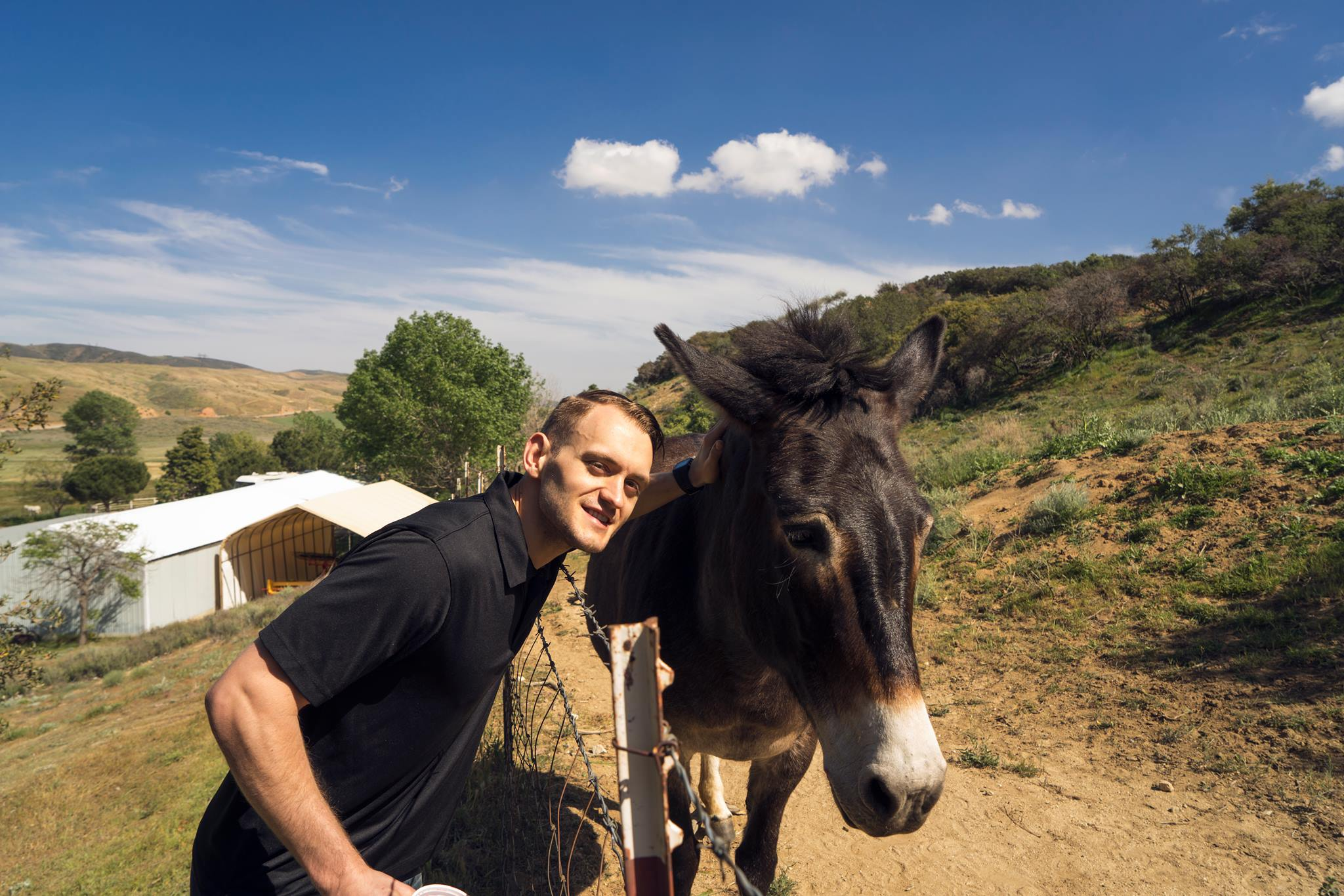Jason's identical twin hanging with a donkey on Easter at his wife's family party