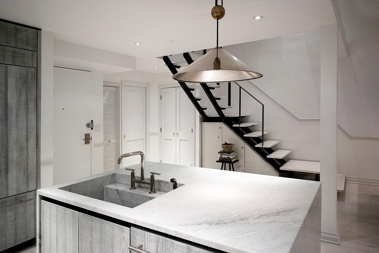eastvillagetriplex-eau-kitchen-counter-stairs.jpg