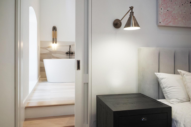 EAU-Tribeca-Loft-master-bed-and-bath.jpg