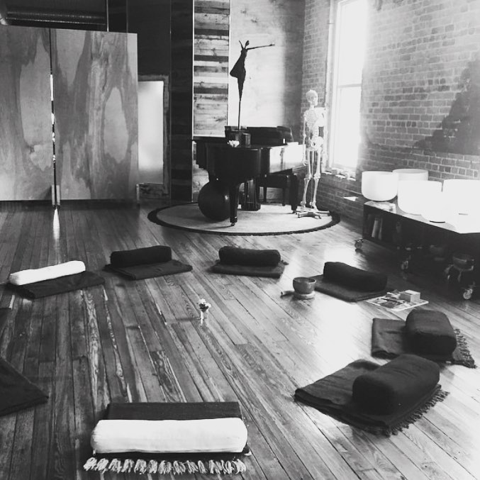 blankets and bolsters in a circle for mindful meditation