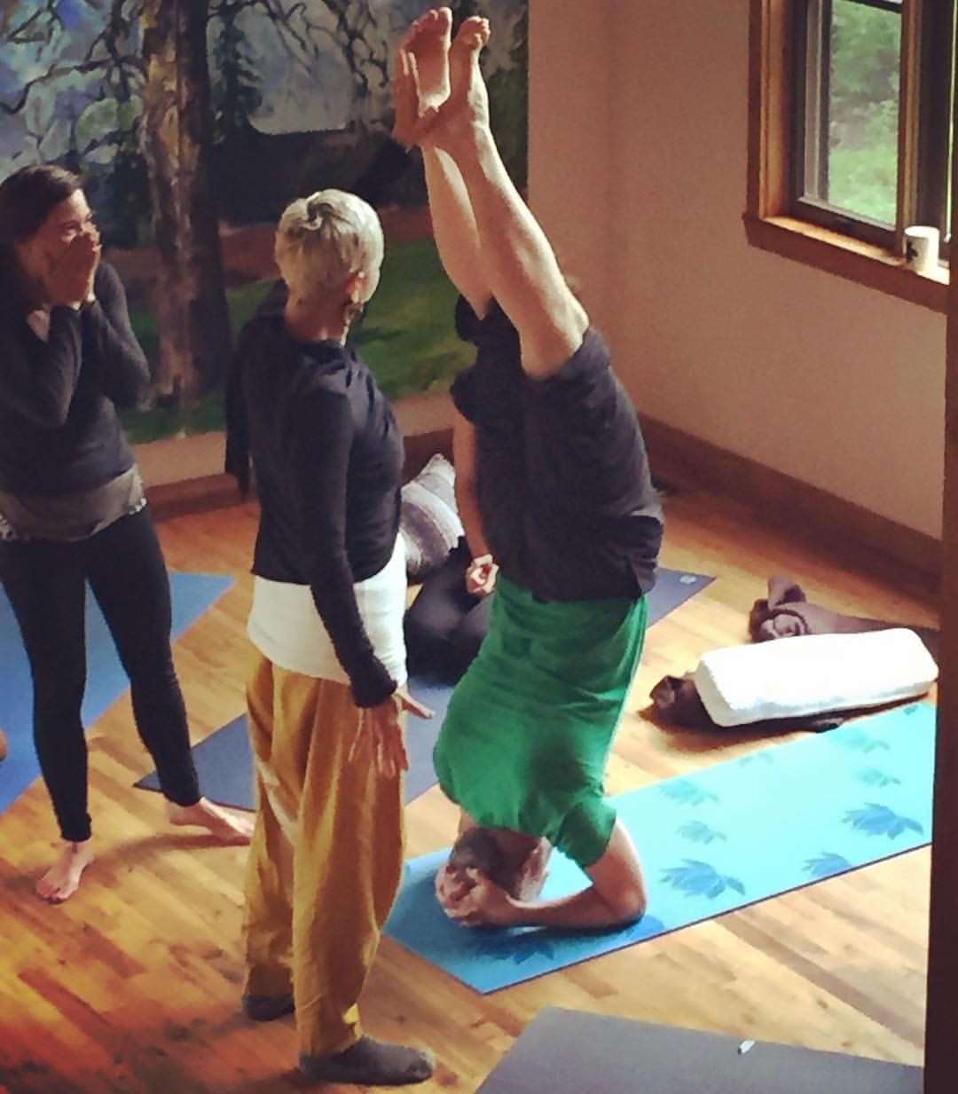 Copy of Nina Be assisting student in headstand during 200 RTY Yoga Teacher Training