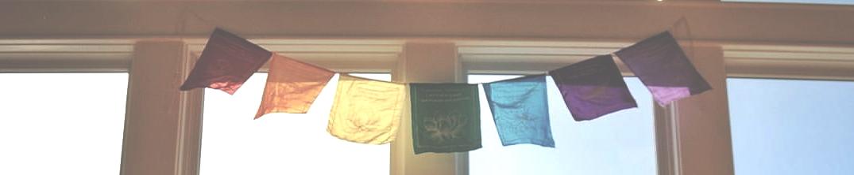 chakra color yoga prayer flags over window