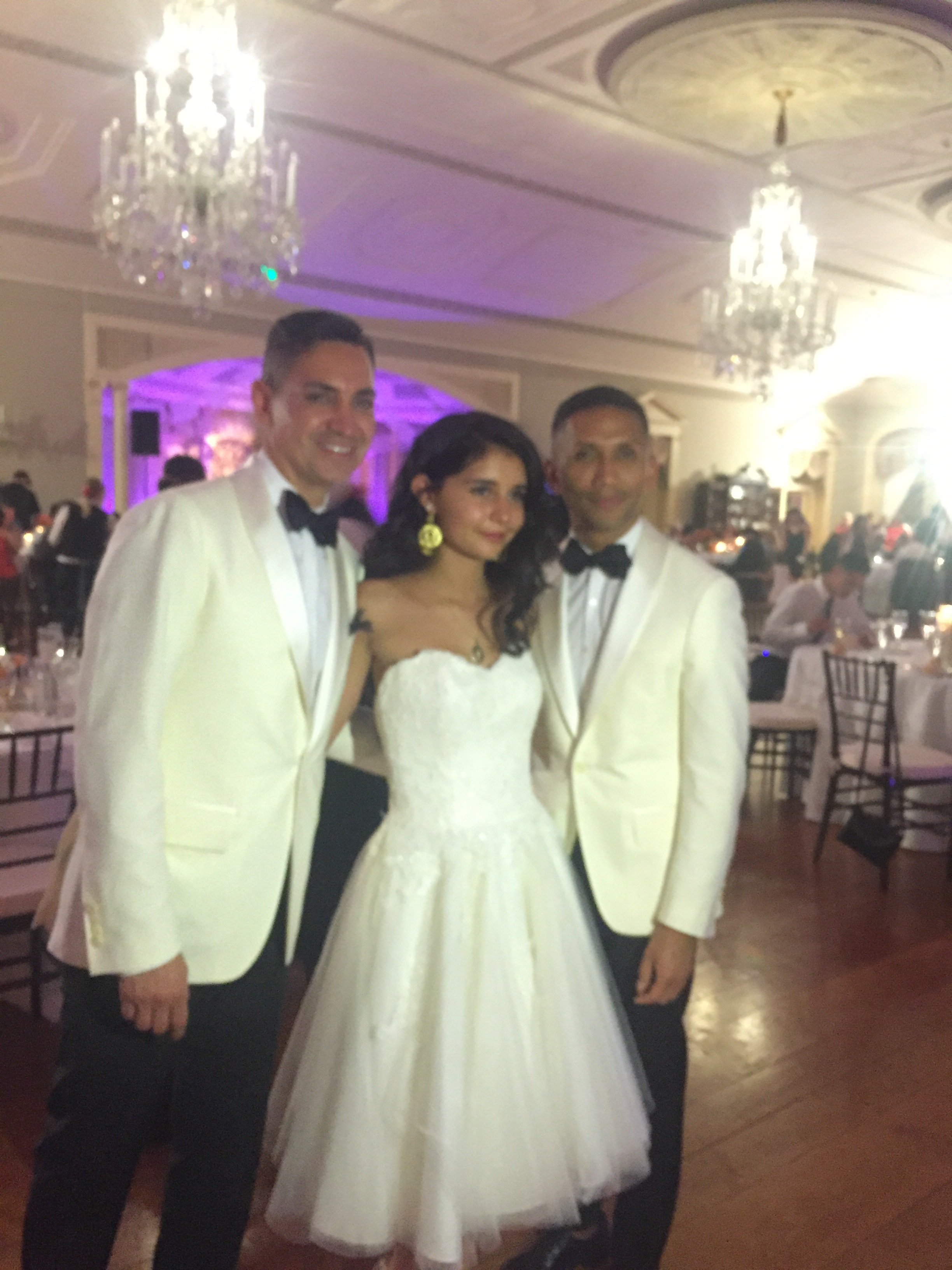 This is Paloma and her two Dad's. She had a big birthday party called a Quinceañera. It was really fancy and there was music and dancing. My mom told me this is a tradition when a Mexican girl turns 15.