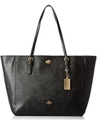 Get her ready for the Summer with this classic  Coach Bag.