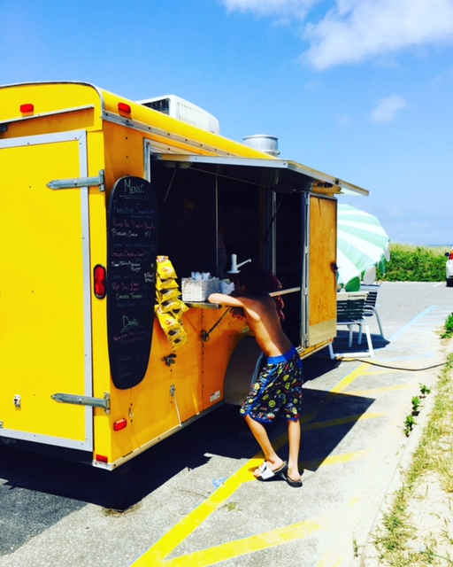 Thank God for this food truck at the beach!! Best fries from Howard. He was from Australia.