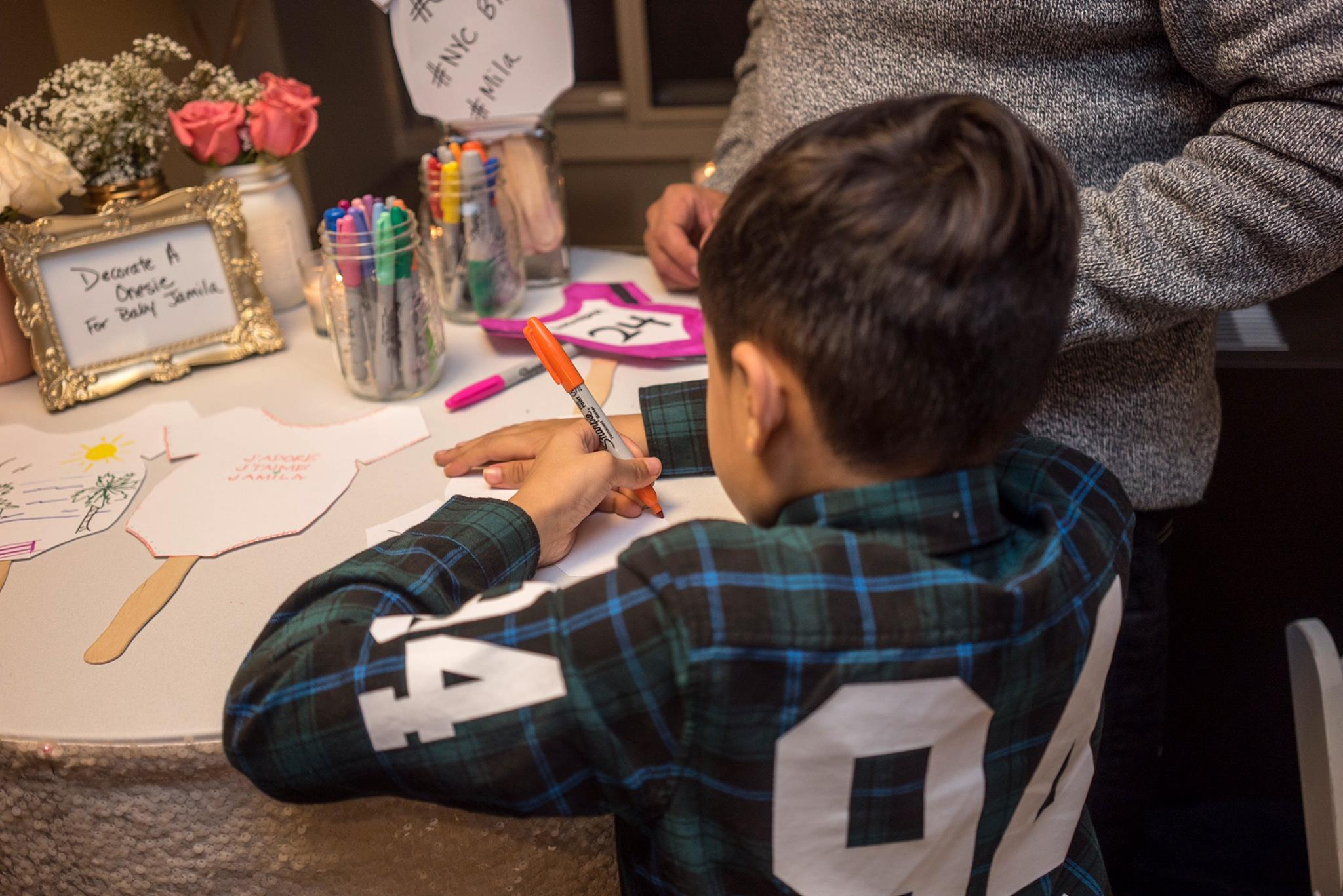 Craft it up! Family baby showers are coed in our culture. Milz and I designing baby tees.