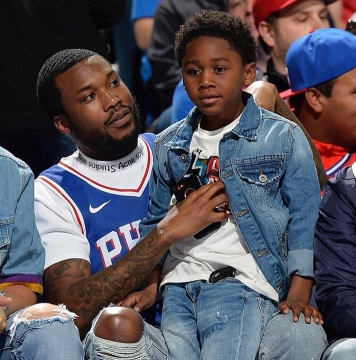 Meek and Son Catch a 76ers game after being release from Prison