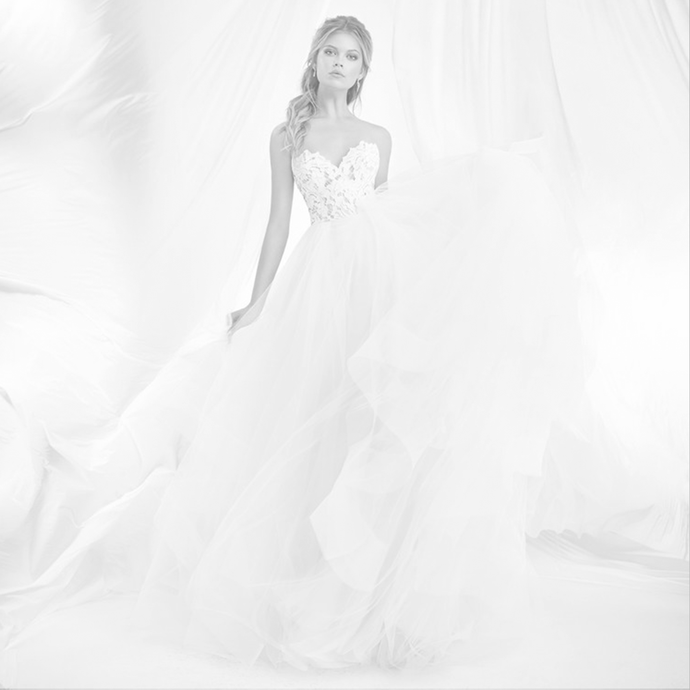Blush by Hayley Paige - All the pizzazz of a signature Hayley Paige gown, but at an accessible price point -- what's not to love? Designed by Hayley Paige, the Blush bridal collection is characterized by casual elegance and femininity.starting at $2,000
